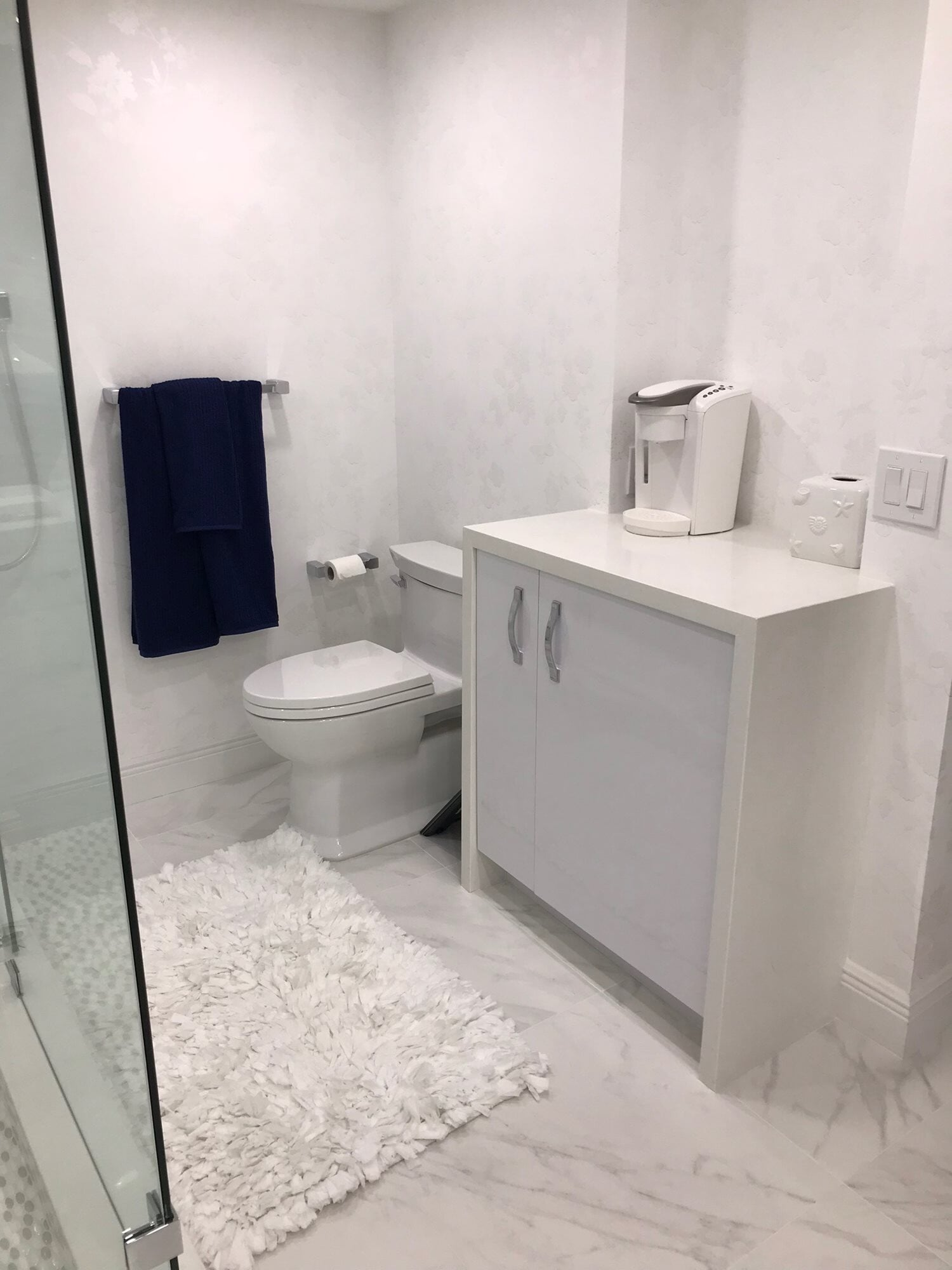 White bathroom design in Juno Beach, FL from Floors For You Kitchen & Bath