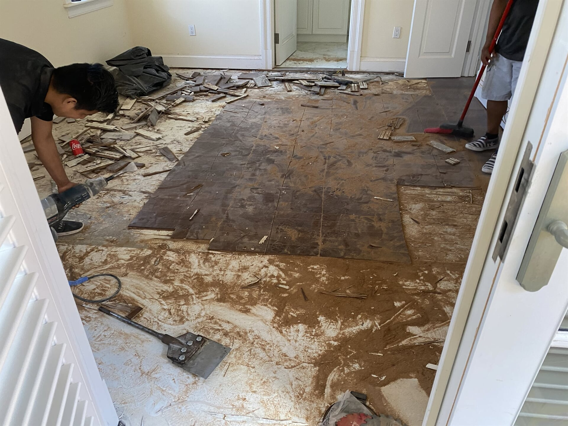 Removing old flooring in Juno Beach, FL from Floors For You Kitchen & Bath