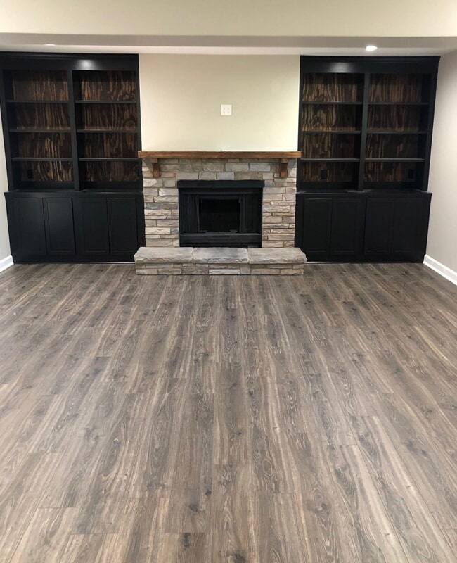 Grey wood look flooring in Northern Tennessee from Shop at Home Carpets
