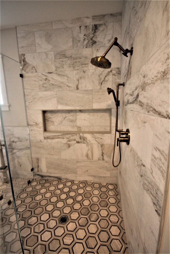 Cape Cod Master Bathroom Roll Tile  Floor Limestone Hexagon Mosaic  Chenille White Blend Honed  Marble walls Saphine White Radiant Heat Floor in Barnstable, MA from Paramount Rug Company