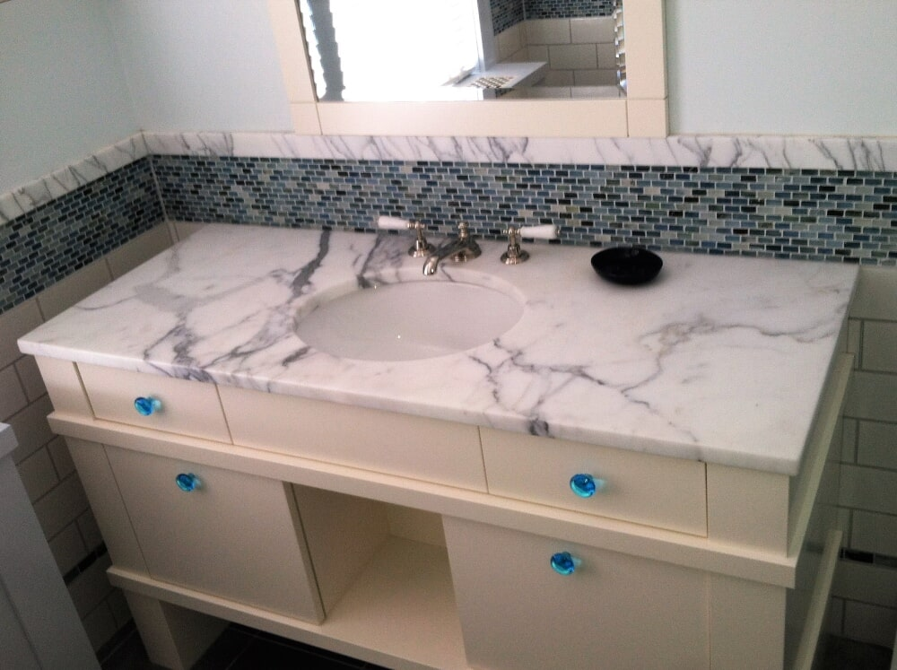 Carrar Marble and  glass mosaic wall tile in Hyannis, MA from Paramount Rug Company