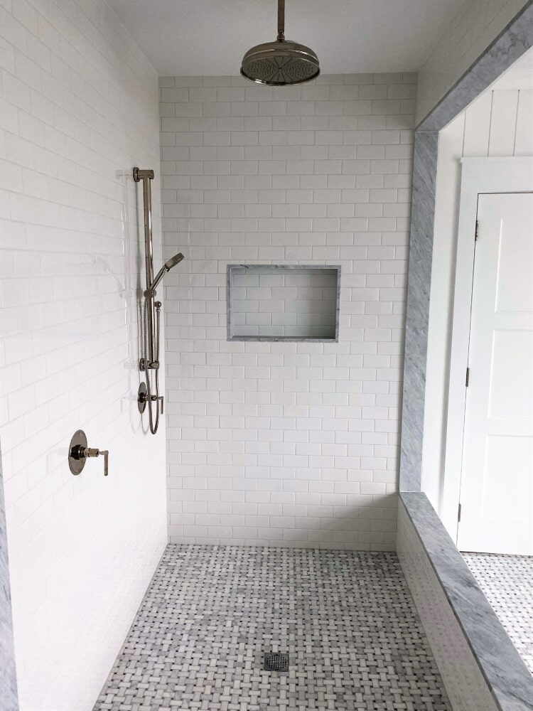 Front Shower Stall Carrara Marble Basket Weave Floor with Black Accent and Ceramic Ravenna Urban Subway Wall Tile Bianco in Hyannis, MA from Paramount Rug Company