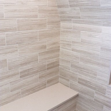 New Seabury Cape Cod - Large Tiburon Gray Wave Porcelain Wall Tile - Shower Bench - Herringbone  Design Tile Floor3 in Mansfield, MA from Paramount Rug Company