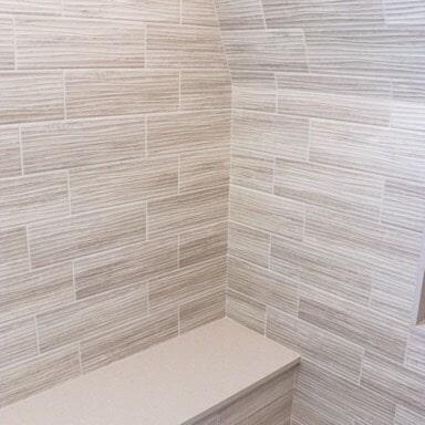 New Seabury Cape Cod - Large Tiburon Gray Wave Porcelain Wall Tile - Shower Bench - Herringbone  Design Tile Floor3 in Bridgewater, MA from Paramount Rug Company