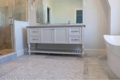 New Seabury Carrara Marble Floor with Herrigbone Pattern in Sandwich, MA from Paramount Rug Company