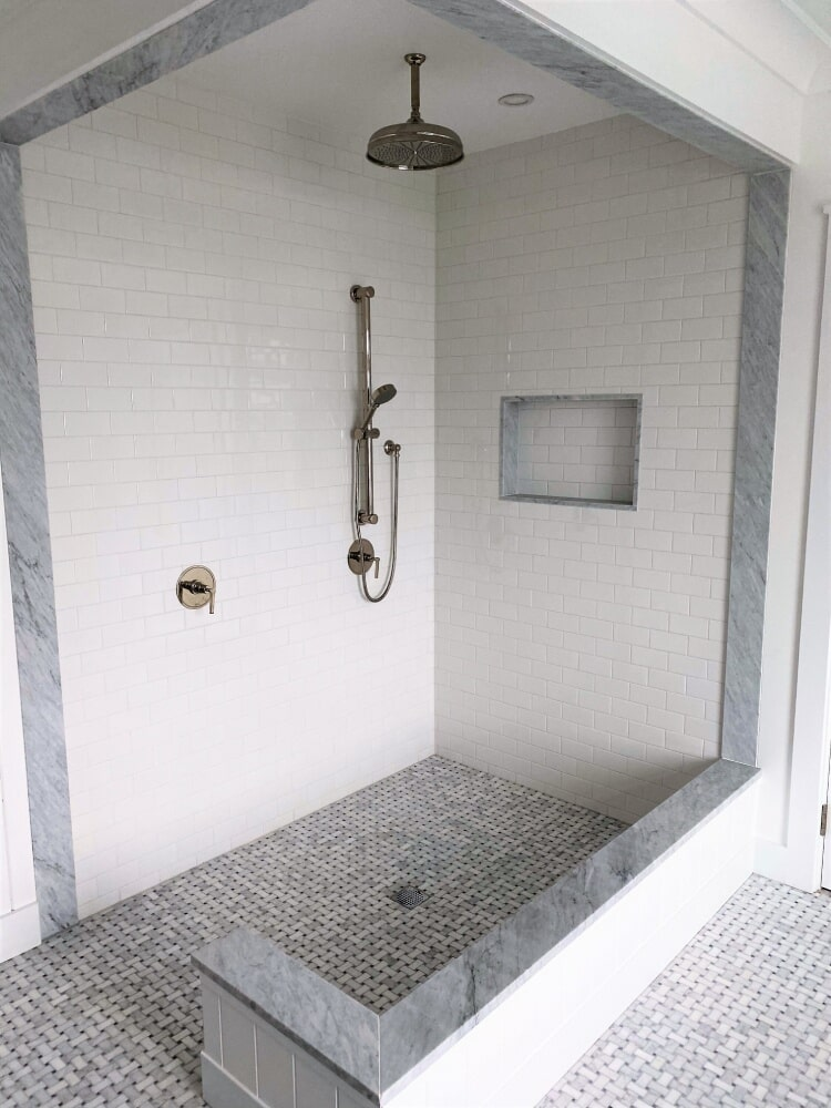 Shower Stall Carrara Marble Basket Weave Floor with Black Accent and Ceramic Ravenna Urban Subway Wall Tile Bianco in Bridgewater, MA from Paramount Rug Company