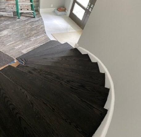 Dark wood stairs in Boca Grande, FL from Williford Flooring Company Inc.