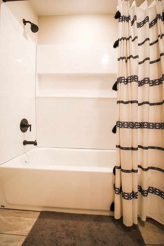 Tile shower and bath at 'The James' from Pioneer Floor Coverings & Design