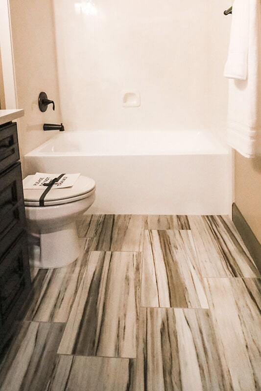 Gorgeous bathroom flooring at 'The Falabella' from Pioneer Floor Coverings & Design