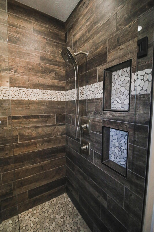 Wood look tile shower at 'Radharc A' Gleann' from Pioneer Floor Coverings & Design