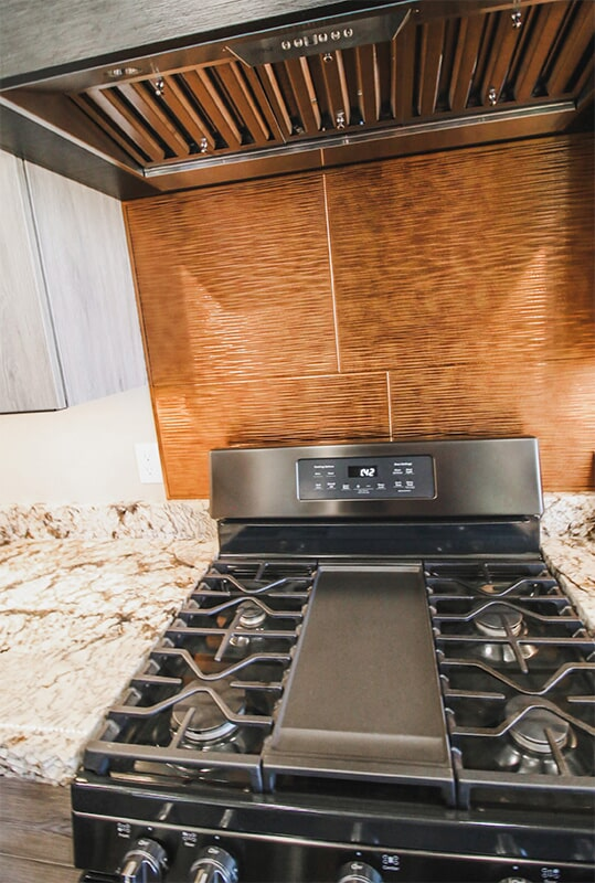 Custom backsplash and range at 'Elements at Sunset' from Pioneer Floor Coverings & Design