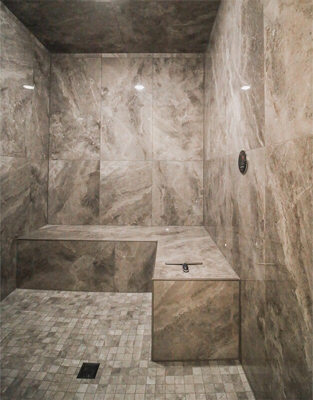 Large shower design at 'Elements at Sunset' from Pioneer Floor Coverings & Design