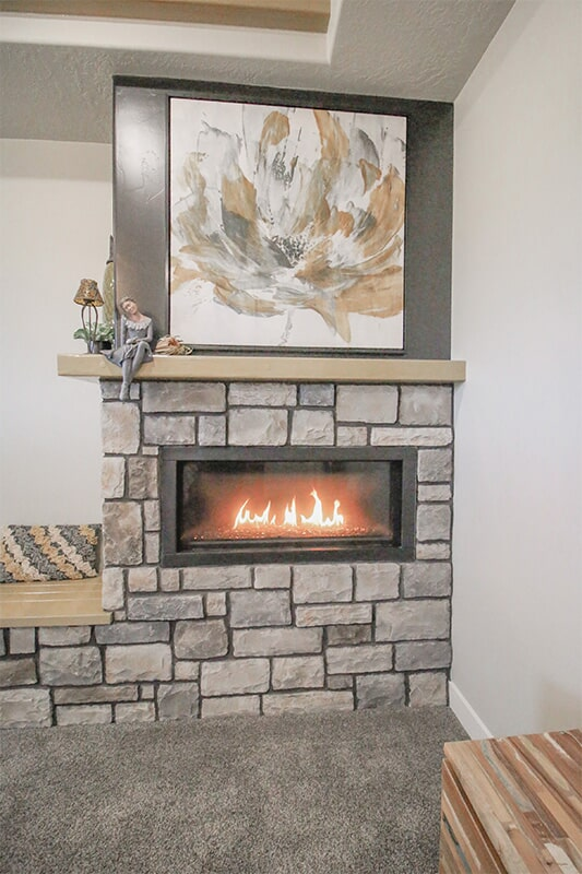 Custom fireplace at 'Elements at Sunset' from Pioneer Floor Coverings & Design