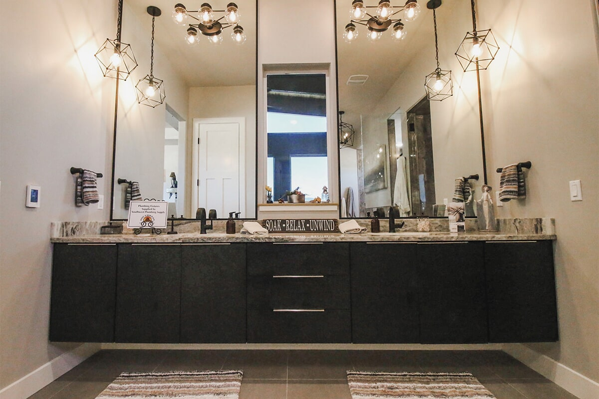 Custom floating vanity at 'Elements at Sunset' from Pioneer Floor Coverings & Design