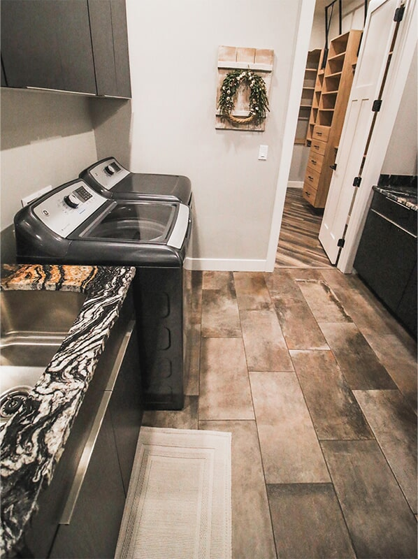 Laundry room design at 'Elements at Sunset' from Pioneer Floor Coverings & Design