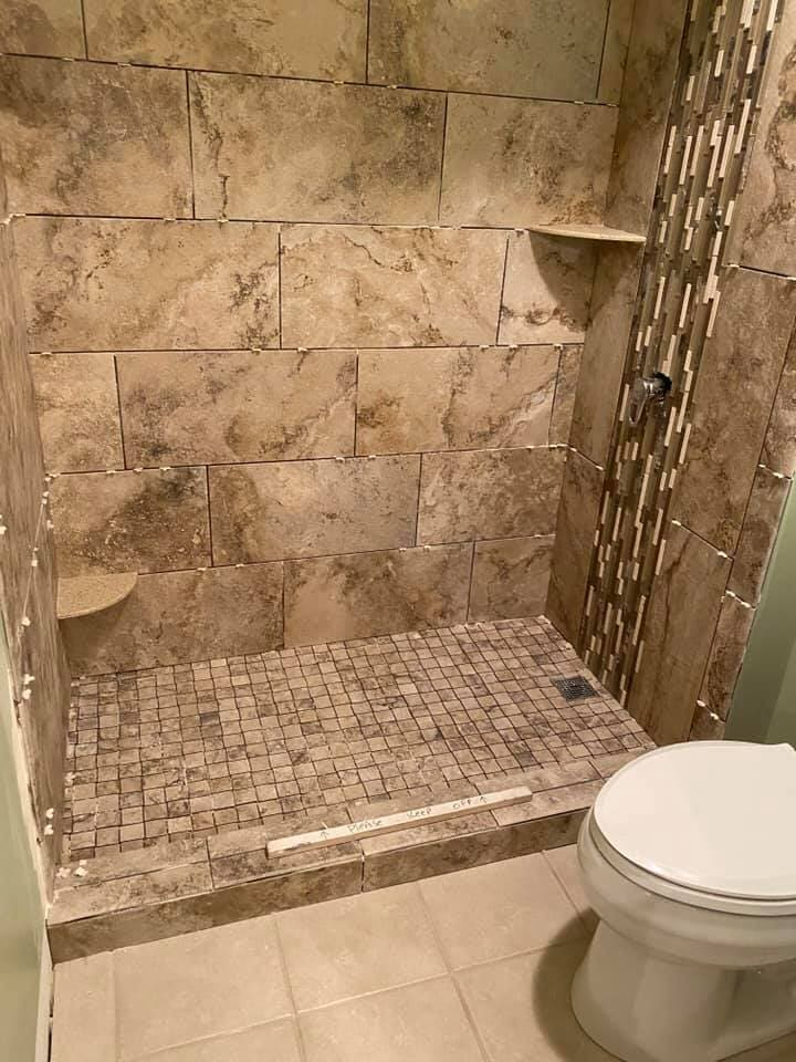 Natural stone shower in Richmond, IL from Anderson Tile & Carpet