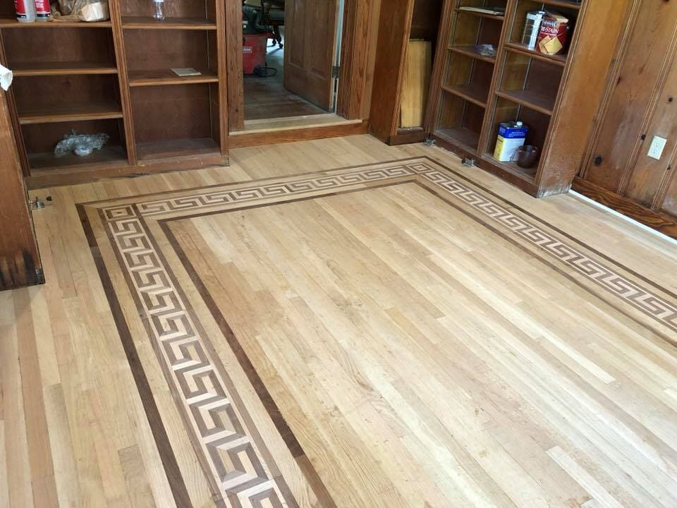 Custom hardwood flooring inlay in Texarkana, TX from Carter Adams Flooring