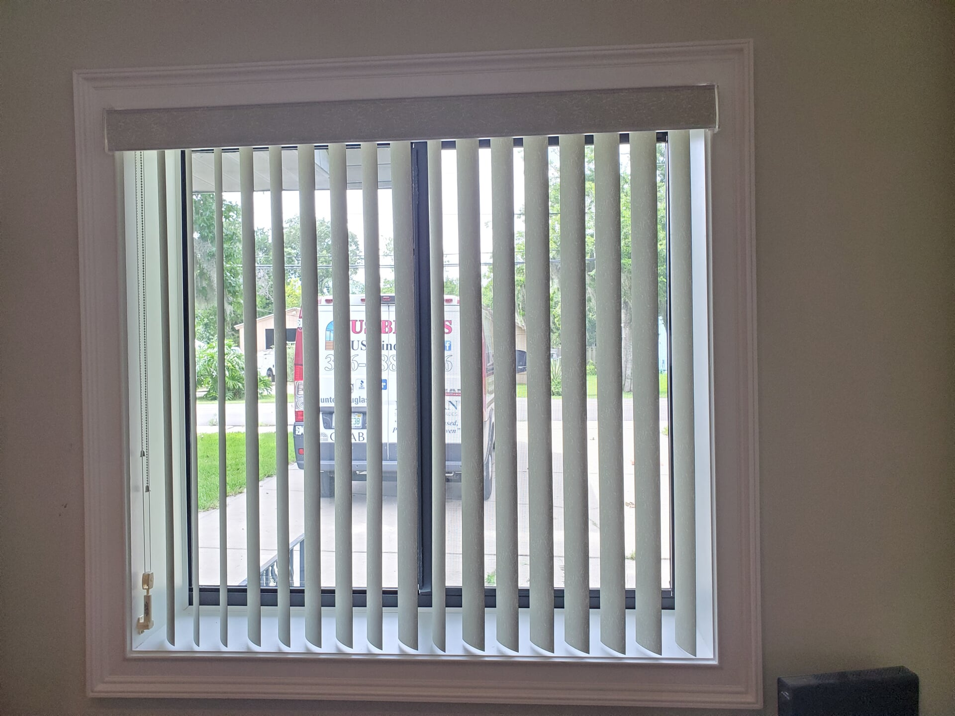 Vertical Blinds with US Blinds truck in background-min
