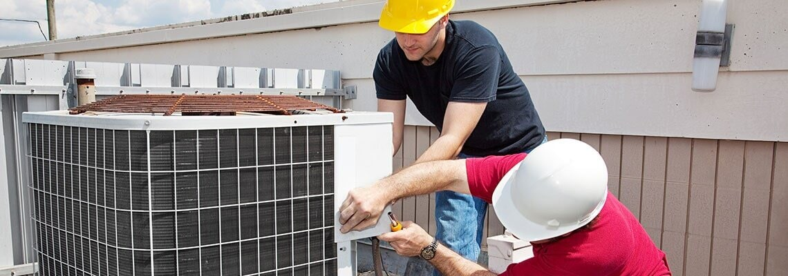 contractor repairing the AC split unit