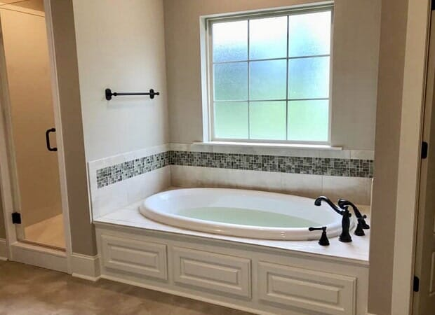 Gorgeous bathroom design in Gonzales, LA from Marchand's Interior & Hardware