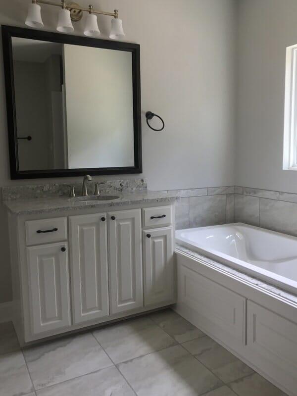 Grey bathroom design  in Gonzales, LA from Marchand's Interior & Hardware