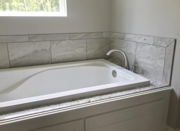 Granite tub surround in Gonzales, LA from Marchand's Interior & Hardware