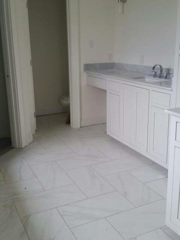 White bathroom design in Baton Rouge, LA from Marchand's Interior & Hardware