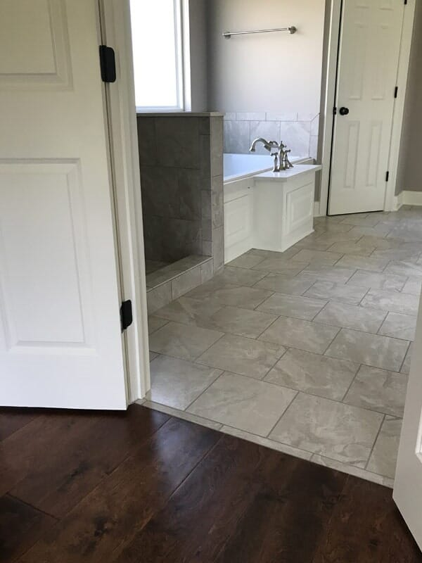 Bathroom flooring transition in Gonzales, LA from Marchand's Interior & Hardware