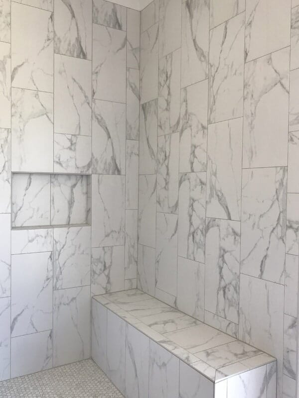 Marble tile shower in Donaldsonville, LA from Marchand's Interior & Hardware