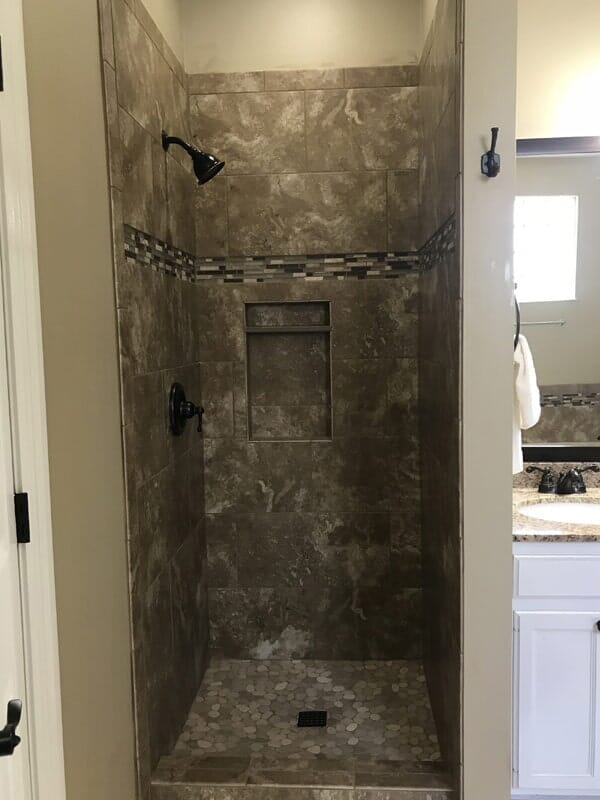 Natural tile shower in Gonzales, LA from Marchand's Interior & Hardware