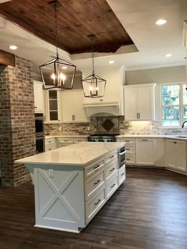 Exposed brick kitchen design in Prairieville, LA from Marchand's Interior & Hardware
