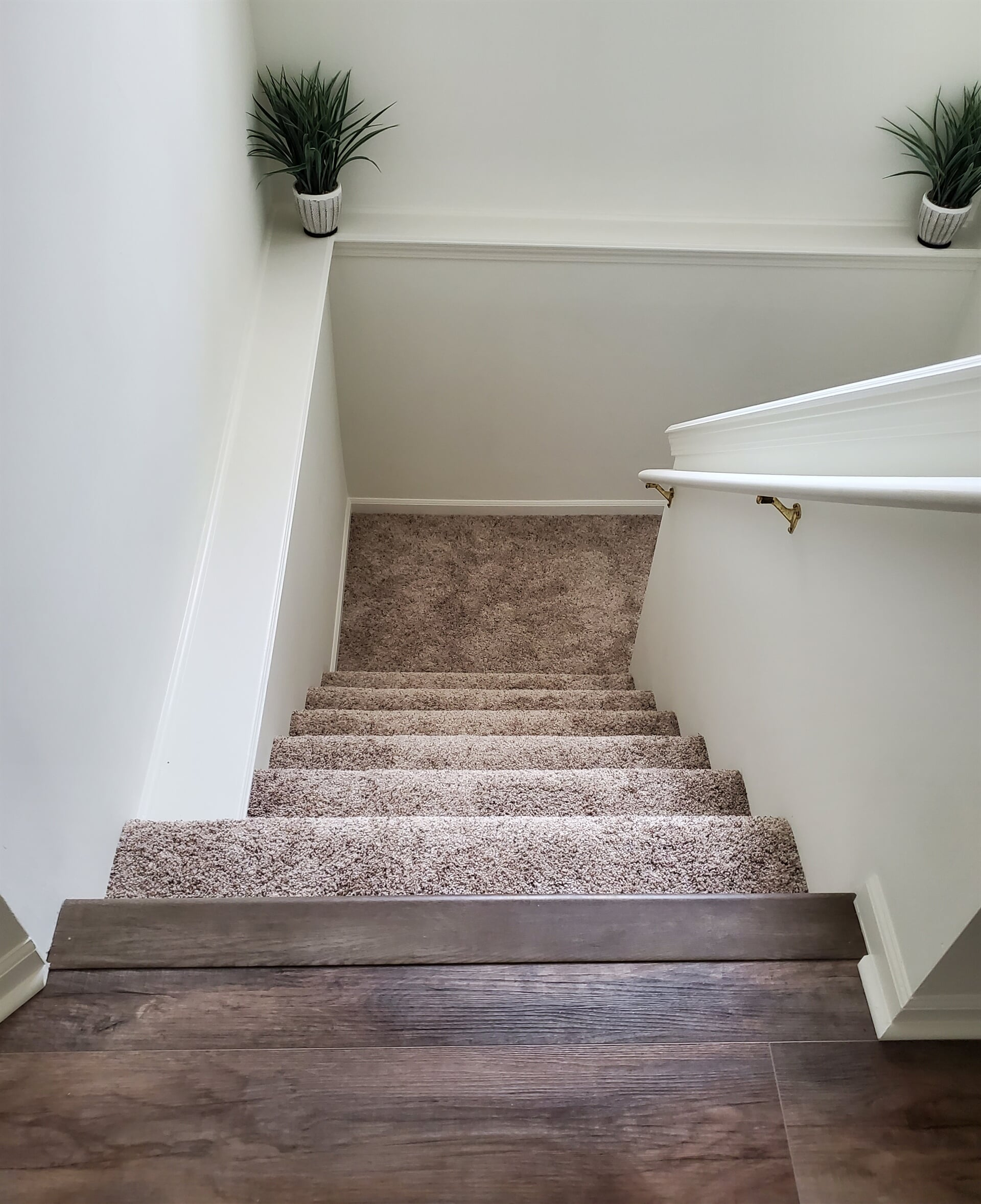 Stair flooring transition in Grand Haven, MI from Absolute Floor Covering