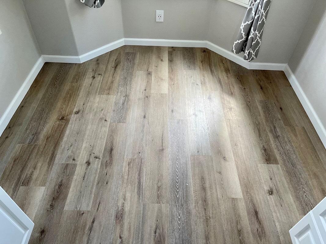 Builder's Choice: Aged Hickory vinyl plank flooring installation in Pearl City, HI