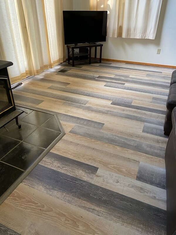The flooring is a Mohawk vinyl floor, the style of the flooring is called Perfect Haven and the color is Nomadic Desert. Installation by Top Line Floors