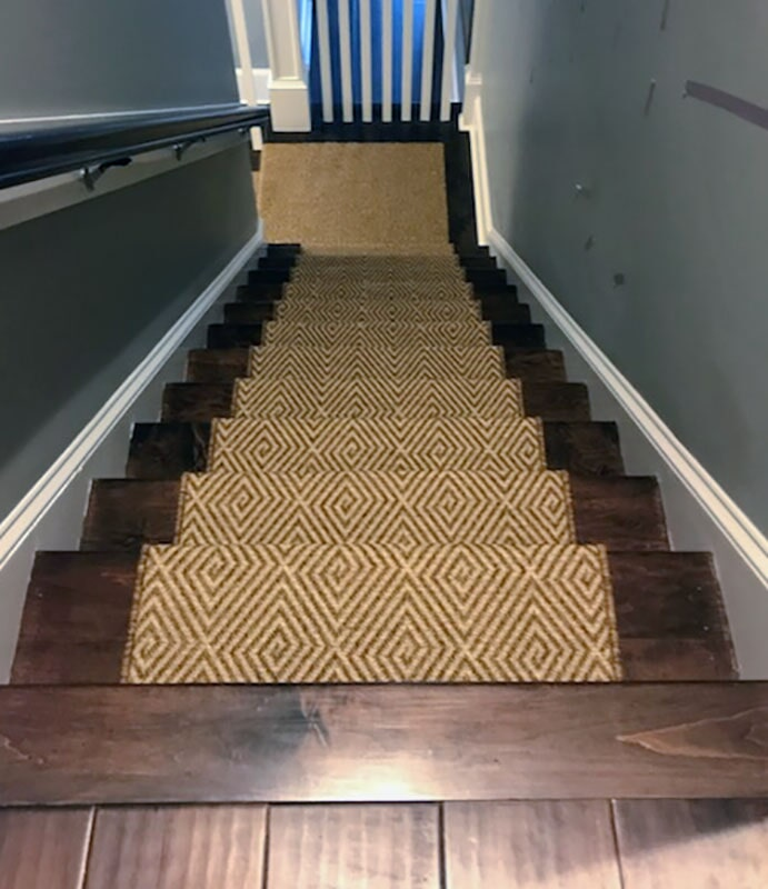 Hardwood stairs with stair runner in  from Bell's Carpets & Floors