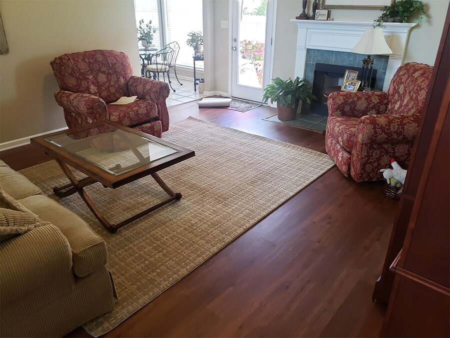 Hardwood flooring and area rug from Carpet Outlet Of Shelby County in Columbiana, AL